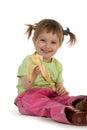 Little girl eats a banana Royalty Free Stock Photos