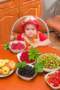 The little girl eats a berry Royalty Free Stock Image