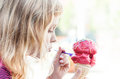 Little girl eats big ice-cream in the park Stock Images
