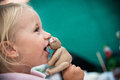 little girl eats cake Royalty Free Stock Photo