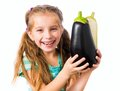 Little girl with eggplant
