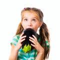 Little girl with eggplant