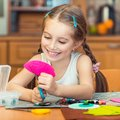 Little girl is engaged in needlework happy cute at home Stock Images