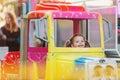 Little girl enjoying fun fair ride, amusement park Royalty Free Stock Photo