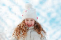 Little girl enjoying nature on a winter walk laughing clouds sky background Stock Images