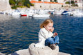 Little girl enjoying sea view Royalty Free Stock Photo