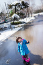 Little girl enjoys playing outside fresh winter snow Royalty Free Stock Images