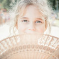 Little girl with fan portrait of Stock Photos