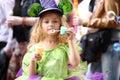 A little girl in fancy green dress blow soap bubbles Royalty Free Stock Photo