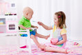Little girl feeding baby brother Royalty Free Stock Photo
