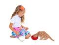 Little girl feeding kitten with milk cute isolated on white background Stock Photos