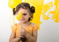 Picture : Little girl feeling happy while painting home wall laptop  eating