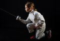 Little girl in fencing costume attacking without mask and weapon lower position Royalty Free Stock Photography