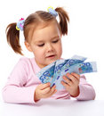 Little girl with few paper euro banknotes Royalty Free Stock Photos