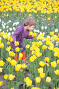 Little girl on field of tulips Royalty Free Stock Photo