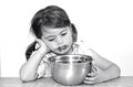 Little girl finished to eat big bowl of chocolate cream concept photo child children depression dispersed food health care diet Stock Images