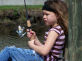 Little girl fishing Sun & Wind Royalty Free Stock Photo
