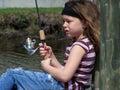Little girl fishing Sun & Wind Royalty Free Stock Photo