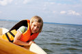 Little girl floats in a boat dressed life vest Royalty Free Stock Images