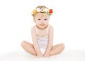Little girl with floral wreath on his head Royalty Free Stock Photo
