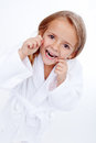 Little girl flossing oral hygiene education in childhood Royalty Free Stock Photography