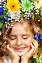 Little girl with flower hairstyle. Stock Images
