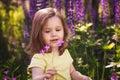 Little girl among the flowers