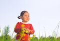 Little girl with flowers dandelion Stock Photo