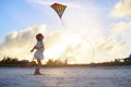 Little girl flying a kite Royalty Free Stock Photo