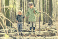 Little girl in the forest with her sister Royalty Free Stock Photo