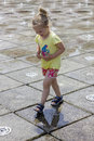 Little girl at the fountains playing fun Royalty Free Stock Photos
