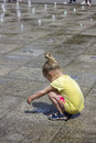 Little girl at the fountains playing fun Royalty Free Stock Image