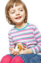 Little girl four years old and guinea pig Royalty Free Stock Photography