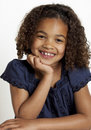 Little girl with frizzy hair smiling Royalty Free Stock Photo