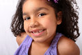 Little girl with front teeth missing Stock Photos