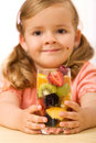 Little girl with fruit drink Royalty Free Stock Photo