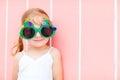 Little girl in funny Christmas glasses Stock Photos