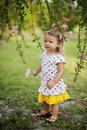 Little girl in garden Royalty Free Stock Photography