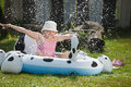 Little girl in garden pool Royalty Free Stock Photo