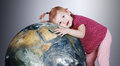 Little girl gently hugs the Earth globe Royalty Free Stock Photos