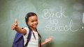 Little girl gesturing thumbs up in classroom portrait of cute the Royalty Free Stock Images