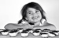 Little girl getting caught eating chocolate cookies cookie concept photo of child children depression dispersed food health care Stock Photos