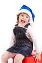 Little girl with gift boxes in Santa's hat Royalty Free Stock Photo