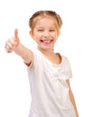 Little girl giving a thumb up isolated on a white background Royalty Free Stock Images