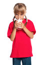Little girl with glass of milk Royalty Free Stock Photos