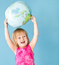 A little girl with a globe Stock Photos