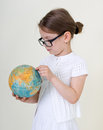 The little girl  and globe. Stock Image
