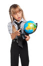 Little girl with globe in school uniform of the world isolated on white background Royalty Free Stock Photo
