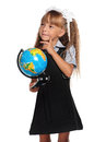 Little girl with globe in school uniform of the world isolated on white background Royalty Free Stock Image