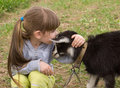 Little girl with goat Stock Images